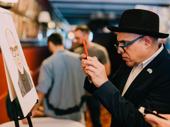 David Yazbek snaps a picture of his portrait.