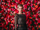 Angels in America standout Denise Gough poses in front of the flower wall.