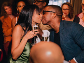 Party time! Nicolette Robinson and her husband Leslie Odom Jr. share a smooch on her big night.