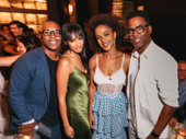 Leslie Odom Jr. and Nicolette Robinson snap a pic with comedy king Chris Rock and guest.