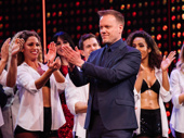 The Cher Show director Jason Moore applauds the cast on opening night.