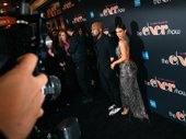 Kanye West and Kim Kardashian pose on the red carpet.