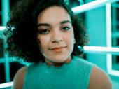 Camila Canó-Flaviá plays the secretary.