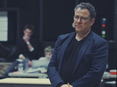 Director Michael Greif takes in the rehearsal performance.