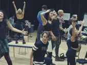 The Rent Live! cast performs a number in rehearsal.