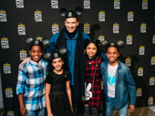 Stephen Carlile poses with his kid cast mates from The Lion King