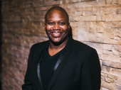 Stage and screen fave Tituss Burgess is all smiles.