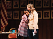 Rosdely Ciprian and Heidi Schreck hug during opening night curtain call.