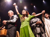 Amber Gray, Patrick Page and the company of Hadestown take in the crowd.