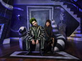 Alex Brightman as Beetlejuice and Sophia Anne Caruso as Lydia in Beetlejuice.