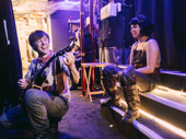 Hadestown co-stars Reeve Carney and Eva Noblezada take a moment backstage.