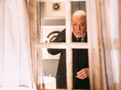 Hadestown Tony nominee Patrick Page checks his reflection before stepping out.