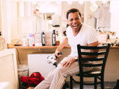 Ain't Too Proud Tony nominee Derrick Baskin is all smiles in his dressing room.