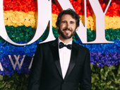 Presenter Josh Groban flashes a smile.