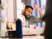 Come From Away's De'Lon Grant zhushes the hair.