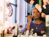 Come From Away's Q. Smith does her makeup.