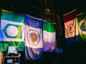 Backstage at the Schoenfeld, there are flags from all the various towns and cities in New Foundland.