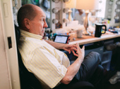 Come From Away's Joel Hatch chills out in his dressing room before the show.
