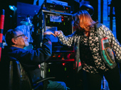 Stage manager Scott Schilk and Sharon Wheatley share a laugh backstage.