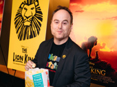 Broadway's The Lion King cast member Jim Ferris munches on popcorn at the theater.