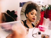 Tony nominee Lilli Cooper touches up her lipstick during intermission.