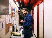 Oklahoma!'s Will Brill enjoys a snack before show time.