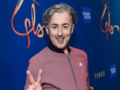 Tony winner Alan Cumming flashes a peace sign.
