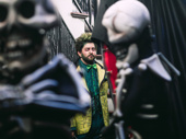 Alex Brightman hangs out amongst the skeletons.