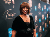 Gayle King flashes a smile on the red carpet.
