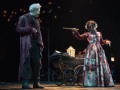 Campbell Scott as Scrooge and LaChanze as The Ghost of Christmas Present in A Christmas Carol.