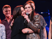 Alanis Morissette and director Diane Paul embrace on stage at opening night.