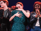 Book writer Diablo Cody embraces cast member Lauren Patten on stage.