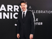 Harry Connick Jr. poses on the after-party red carpet.