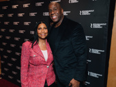 Magic Johnson poses with his wife, Cookie Johnson, before the performance began.