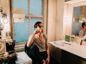 Dylan Frederick brushes his teeth before the show.