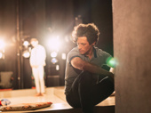 Kyle Harris onstage, as shot from the wings. He plays Jasper, Eric Glass' friend and boss.