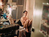 Dylan Frederick waits for his next scene backstage; he plays young Walter in The Inheritance.
