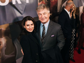 Actors Hilaria and Alec Baldwin smile on the red carpet.