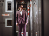 Rob McClure suits up to take the train to New York.