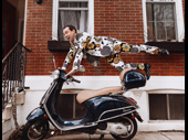 Rob McClure shows off his Vespa in front of his Philadelphia home.