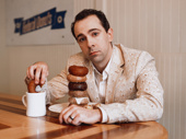 Rob McClure stacks his favorite Federal Donuts.