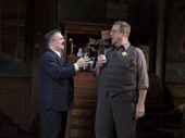 Nathan Lane as Walter Burns and John Goodman as Sheriff Hartman in The Front Page.