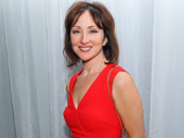 Broadway bright star Carmen Cusack dazzles in red at her opening night performance in Sunday in the Park with George.