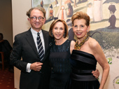 Tony-winning costume designer William Ivey Long and New York City Center President and CEO Arlene Shuler congratulate the evening's honoree, producer Adrienne Arsht.
