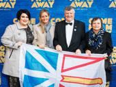 Wave that flag! Kelly Scevior, fellow Newfoundlander, Mayor Claude Elliott & Gerri Elliott celebrate opening night.