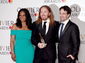 A trio of greats! Tony winners Audra McDonald and Lin-Manuel Miranda presented Groundhog Day music man Tim Minchin with the Olivier Award for Best Musical.(Photo: Getty Images)