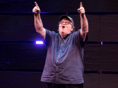 Michael Moore takes in the crowd on opening night of The Terms of My Surrender.