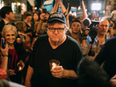 The Terms of My Surrender star Michael Moore unites with the crowd to head to Donald Trump protest.
