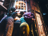 Hello, audience! BAshley Bryant, Akron Watson, Clifton Duncan and Jonathan Fielding peek through the window.