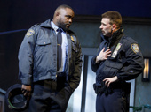 Brian Tyree Henry as William and Chris Evans as Bill in Lobby Hero.